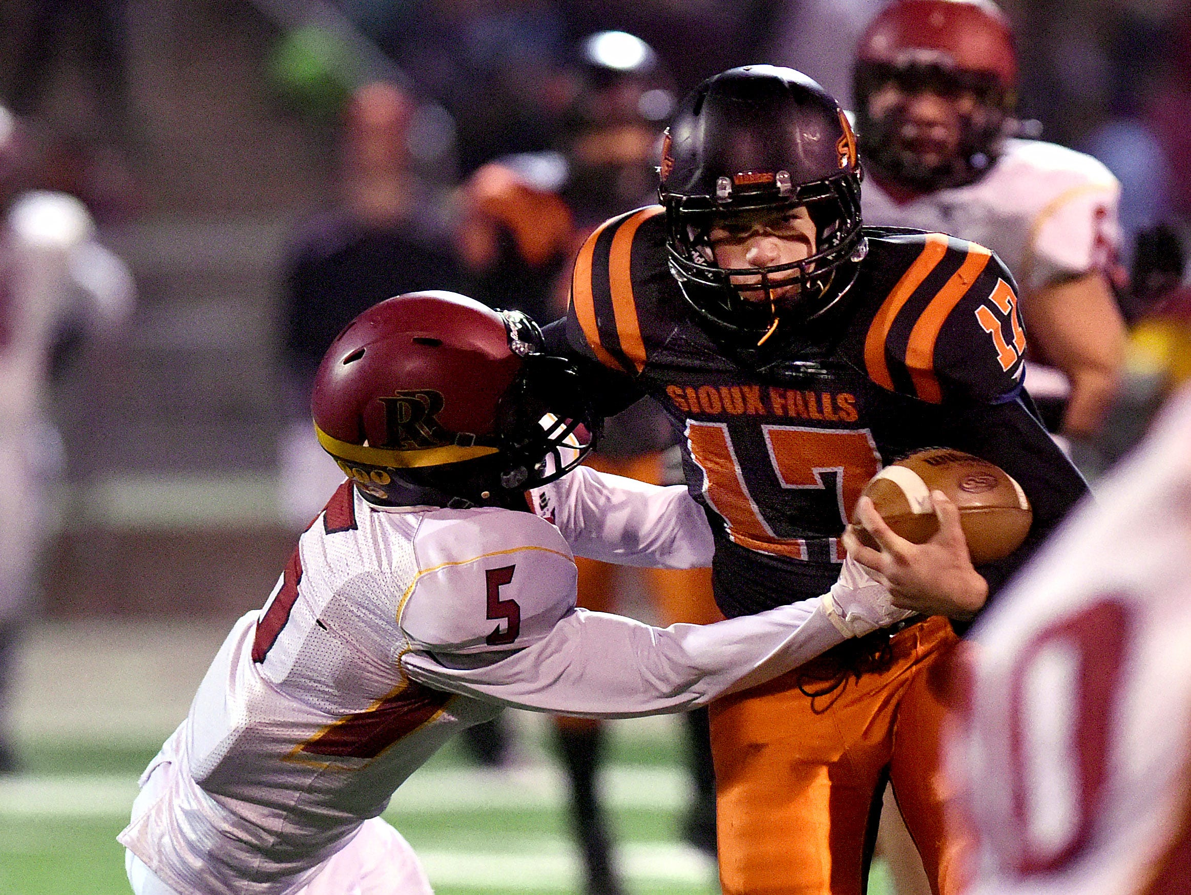 Washington's Seth Benson is stopped by Roosevelt's Evan Warkenthien on Thursday at Howard Wood Field.