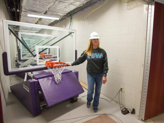 Kristy Ward, Florida SouthWestern State College's women's basketball coach, tours the Suncoast Credit Union Arena at Florida SouthWestern State College in Fort Myers recently. The arena is scheduled to open Nov. 29.