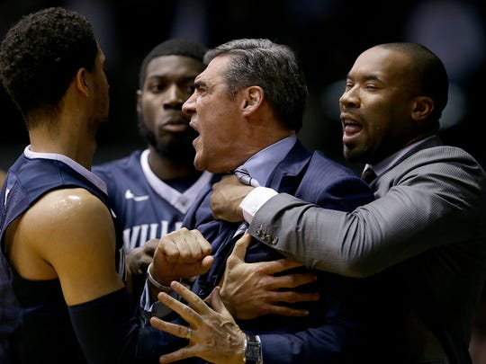 Villanova Wildcats Jay Wright is held back by assistant coach Kyle Neptune after receiving a technical foul in the first half of their game Wednesday, December 4, 2016, evening at Hinkle Fieldhouse.