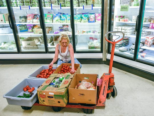 Nikki Kissner sorts donated fruit and vegetables and