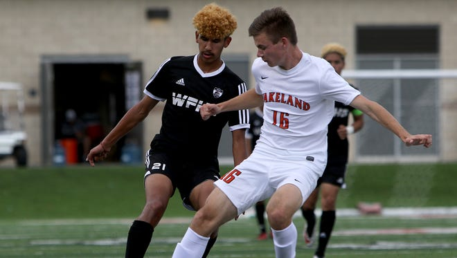 Frisco Wakeland's J.R. Guz (16) kicks the ball out of bounds and away from Wichita Falls High School's Alex Ramirez (21) in the UIL Soccer State Championship semifinal Thursday, April 13, 2017, at Birkelbach Field in Georgetown.