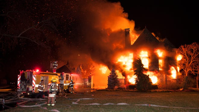 Firefighters battle a four-alarm fire Jan. 19, 2015, at a home in Annapolis, Md. Six of its occupants of were unaccounted for and feared dead.