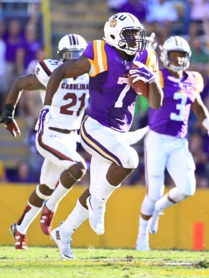 LSU Tigers running back Leonard Fournette (7) runs for an 87-yard touchdown during the third quarter of a game against the South Carolina Gamecocks at Tiger Stadium.