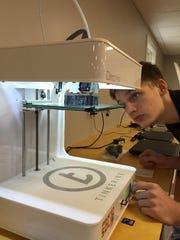 Sanford School freshman Ryan McKeon is using a Tinkerine Ditto Pro 3D printer to create protein models.