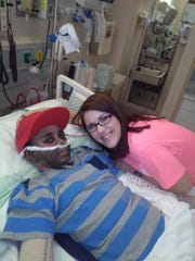 Keith Smith smiles with his nurse Sarah. Keith is slowly recovering and is expected to have surgery Thursday.