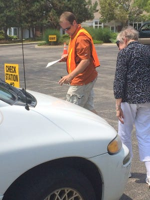 Mercy Health occupational therapist Jason Shulten helps a senior driver.