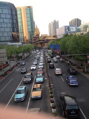 The city of Shanghai as seen from an overhead pedestrian