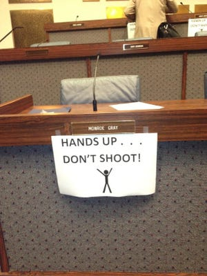 Some Indiaanpolis City-County Council members put these signs up in council chambers Aug. 18, 2014.
