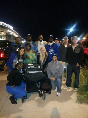 Lorenzo Cain (back row, center) is surrounded by family and friends following Wednesdays World Series game.