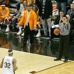 Former Tennessee coach Bruce Pearl watches from the baseline benches at Memorial Gym as Vanderbilt's Shan Foster (32) shoots a technical foul.