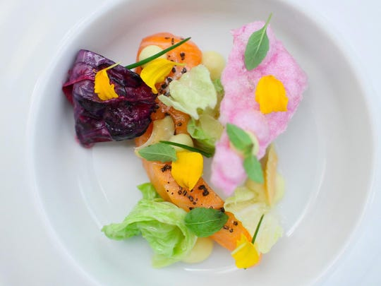 A dish of poached salmon, meyer lemon and red cabbage