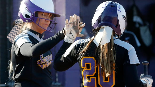 Smyrna's Katie Killen (left) celebrates with teammate Lexie Harper (20) after both scored runs during the first inning of Thursday's 16-0 win over BGA.