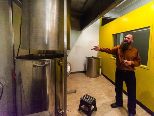 Brinx Jones owner Steve Wozniak shows his two tank