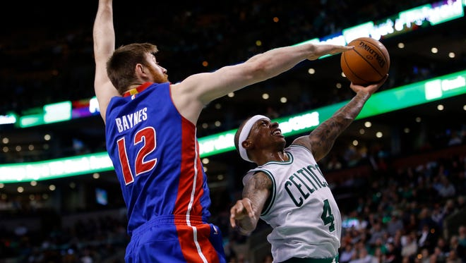 Celtics guard Isaiah Thomas shoots against Pistons center Aron Baynes in the second half of the Pistons' 102-95 loss Feb. 3, 2016 in Boston.