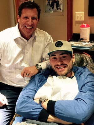 Former Vanderbilt football player Jody Jones, left, is now the dentist for the Predators. He worked on forward Taylor Beck, who lost a front tooth, last Thursday.