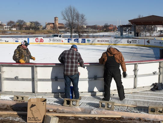 A corner of the Hockey Day Minnesota rink is put into