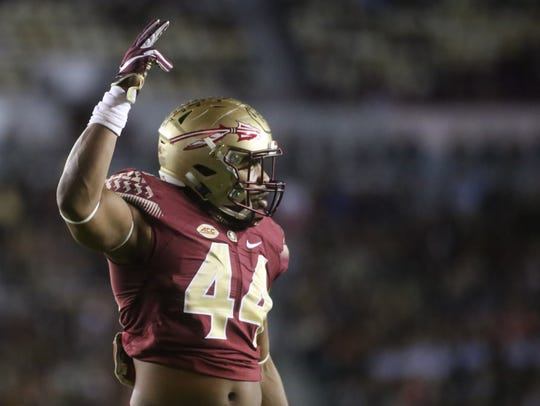 Demarcus Walker (44) pumps up the crowd during the