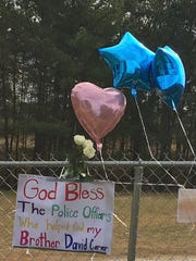 Sign supporting officers and honoring Charles David