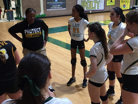 Captain Shreve gets some pointers from coach Marita