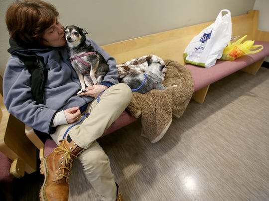Cybelle Burns kisses her dog, Sadie, as she sits inside the Salvation Army in Bremerton. Burns is homeless, and Kitsap Connect is working to find her housing.
