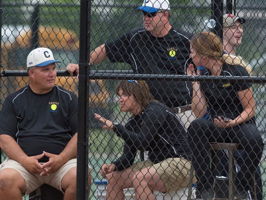 Castle softball coaches, clockwise from left, Pat Lockyear, Scott Fischer, Elanie Arnold and Becky Lis gather for some last-minute strategy in the dugout at North High School before their sectional game against Central last year.