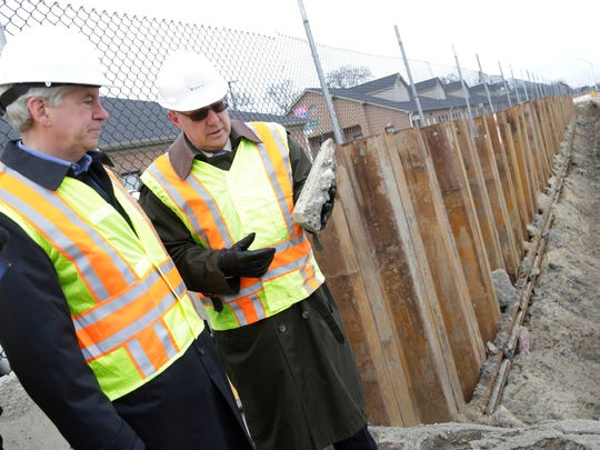 Governor Rick Snyder, left, is joined at the Lodge freeway  by Michigan Department of Transportation Director Kirk Steudle Monday Dec. 1, 2014 in Detroit as they discuss the amount of work that is needed to help fix Michigan roads.