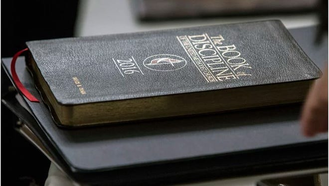 A copy of the UMC Book of Discipline rests on a table during an oral hearing on May 22, 2018, in Evanston, Ill.