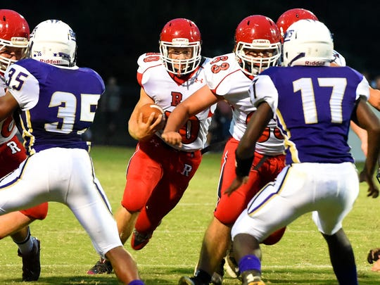 Senior running back Harrison Schaefer, center, has 34 rushing touchdowns for Riverheads this season.