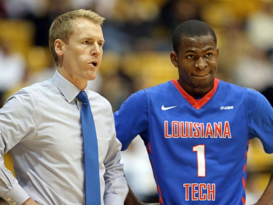 Louisiana Tech Bulldogs head coach Eric Konkol (L) and guard Derric Jean (1) look on from the sidelines against the Southern Miss Golden Eagles in the first half at Reed Green Coliseum.