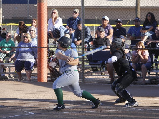 Farmington's Kenna Colebrook hits an RBI single in the first inning against Piedra Vista on Tuesday at the Ricketts Park softball fields.