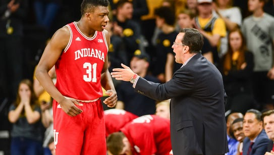 Indiana Hoosiers head coach Tom Crean talks with center