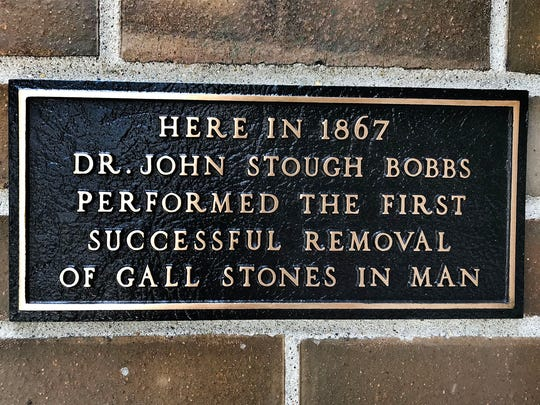 A plaque on the former L.S. Ayres extension building commemorates the first successful removal of gall stones.