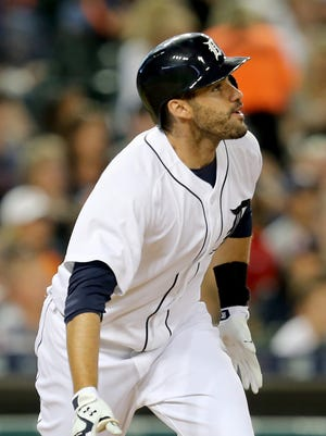 The Detroit Tigers' J.D. Martinez doubles against the Boston Red Sox on Aug. 7, 2015 at Comerica Park in Detroit.
