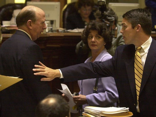 In this 2000 photo, then South Carolina House member Dan Tripp, right, congratulates House Speaker David Wilkins of Greenville.