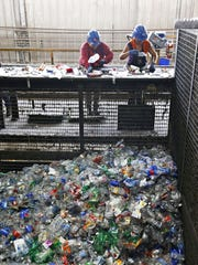 Sorters go to work separating different plastic bottles on the conveyors line at the Glendale M.R.F., or Material Recovery Facility, in Glendale on Aug. 18, 2015.