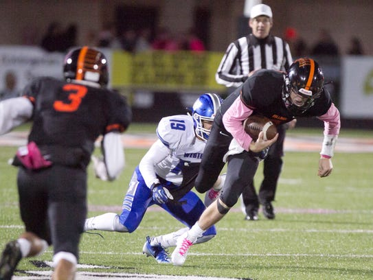 Brighton quarterback Will Jontz runs the ball against