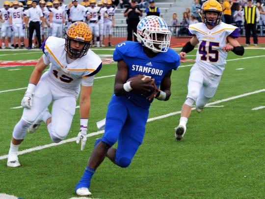 Stamford's Steven Johnson carries the football with