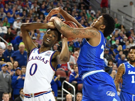 Kansas Jayhawks guard Marcus Garrett (0) battles for the ball with Seton Hall Pirates forward Desi Rodriguez (20)  in the first half in the second round of the 2018 NCAA Tournament