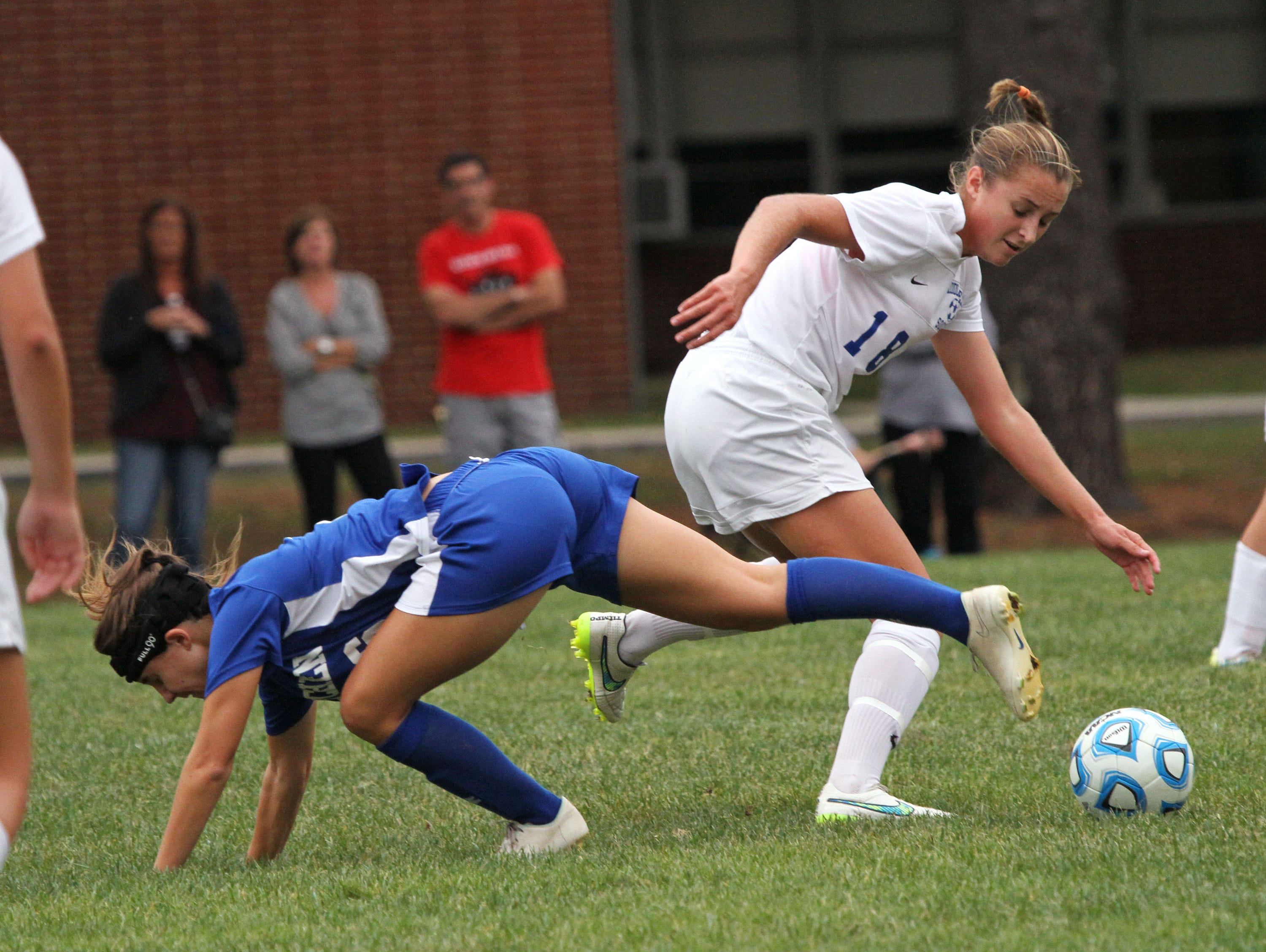 Mackenzie Meixner, right, of Middlesex moves the ball past Metuchen's Carly Taylor in girls soccer game at Middlesex.