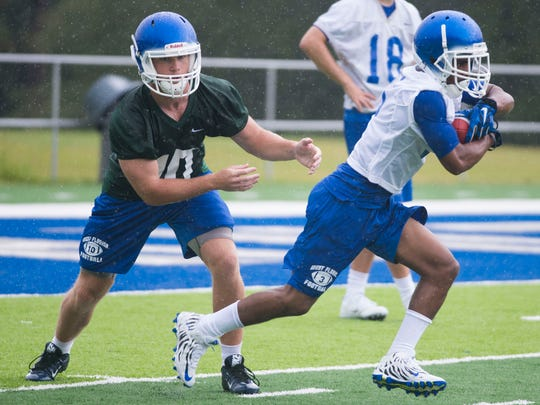University of West Florida quarterback, Grey Jackson, right, practices ball exchange with one of his backs during the team's first regular season practice of the 2016 season. The Argos' begin their long awaited football season with an away game on Sept. 3.