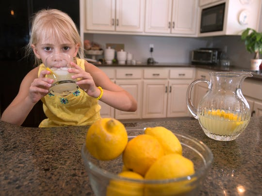 6-year-old Cancer Survivor, Carolyn Hendrix, tests the product she plans to offer at her annual fundraiser to raise money to battle childhood cancer. Hendrix will set up her lemonade stand at Trinity Presbyterian Church on Bayou Blvd Sunday, Sept. 25. from 12:30 p.m. to 5 p.m.