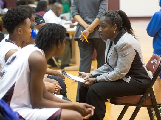 Pensacola High School's girls basketball coach Alison Davis, right, talks with her players before the start of Thursday night's Region 1-7A quarterfinals game against Choctawhatchee High.