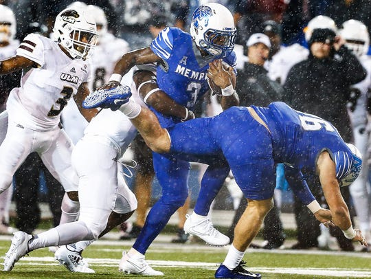 Memphis receiver Anthony Miller (middle) scrambles