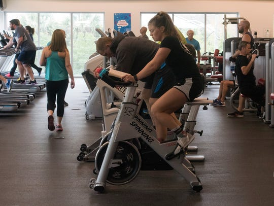 YMCA members get their workouts done Friday, March
