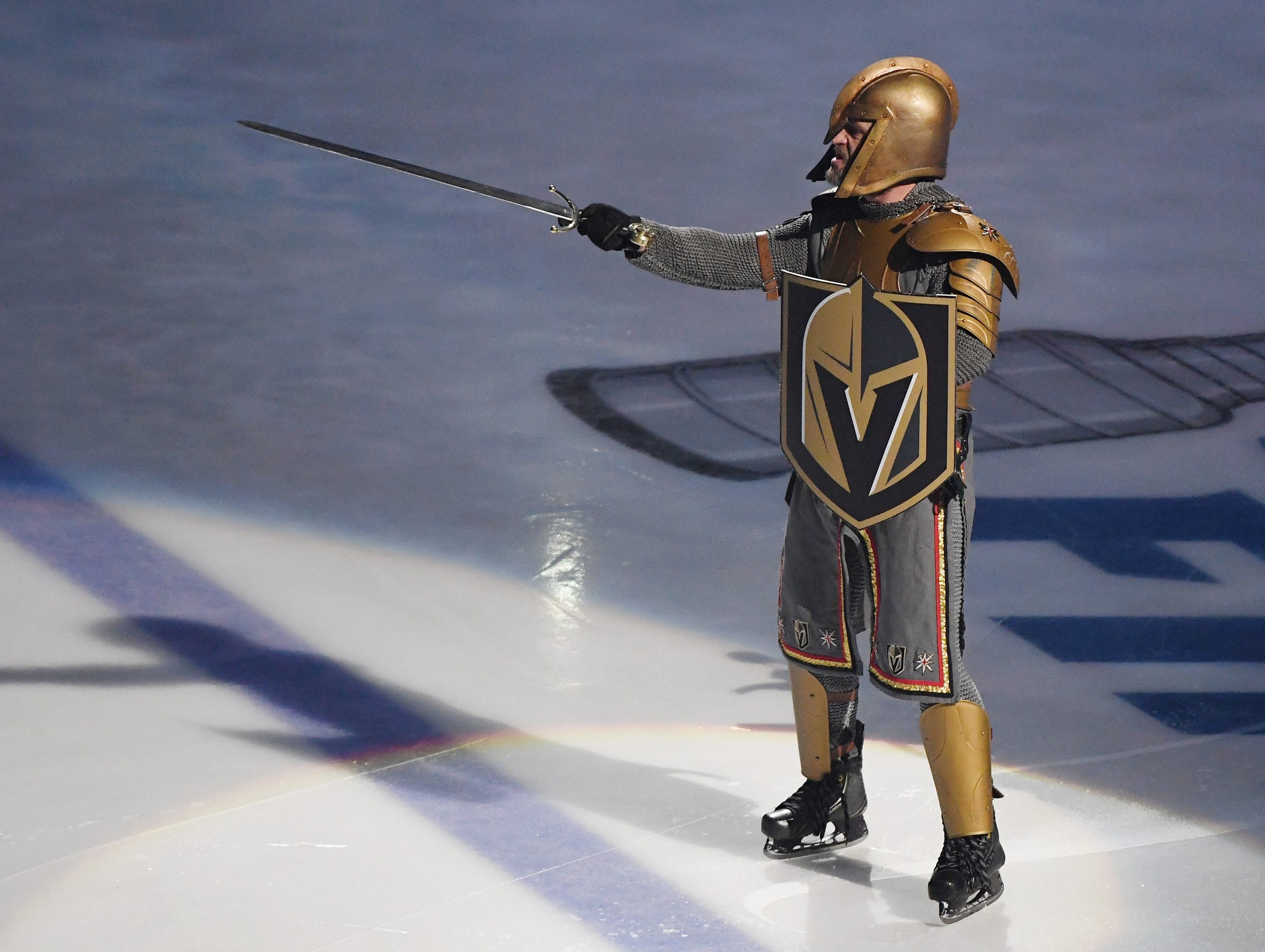 Lee Orchard as the Golden Knight performs during a