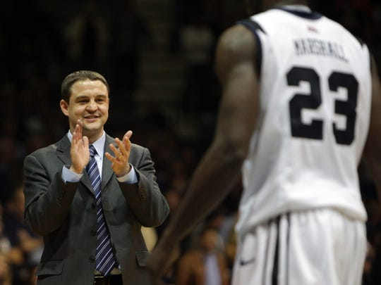 Butler coach Brandon Miller shows his approval at an overtime run for his team against Vanderbilt at Hinkle Fieldhouse, Nov. 19, 2013.