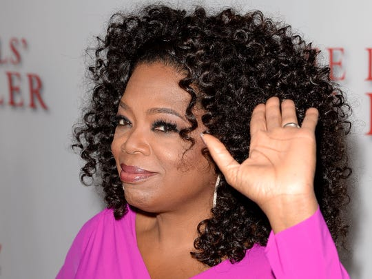 "Oprah Winfrey waves at the premiere of ""Lee Daniels' The Butler"" at Regal Cinemas L.A. Live in 2013."