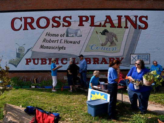 Visitors chat and take home plants at the Cross Plains Garden Club annual plant sale April 13, 2018, in the park beside the public library. The club raises the plants in their homes, then uses the profits from the sale to fund a local scholarship and other community activities.