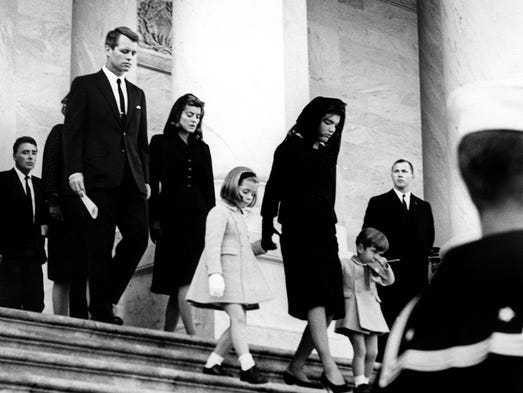 24 November 1963  Mrs. Kennedy and her children leave the Capitol building. L-R: Peter Lawford, Attorney General Kennedy, Patricia Kennedy Lawford, Caroline Kennedy, Mrs. John F. Kennedy, John F. Kennedy Jr.