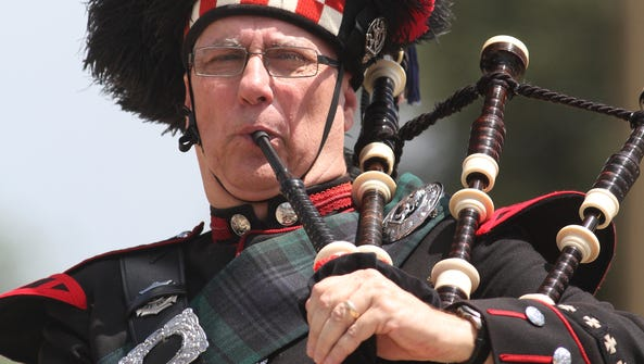 A bagpipe player performs at a funeral in Dallas in